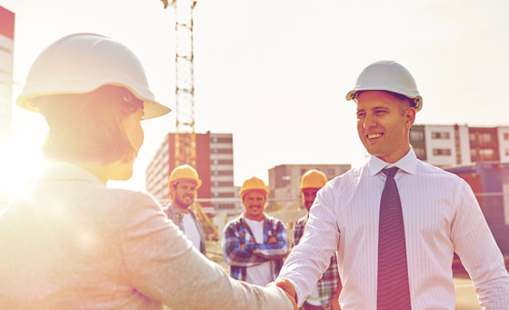 Photo of men on construction site