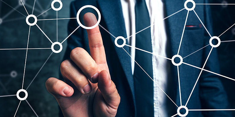 Photo of a hand pointing to a network